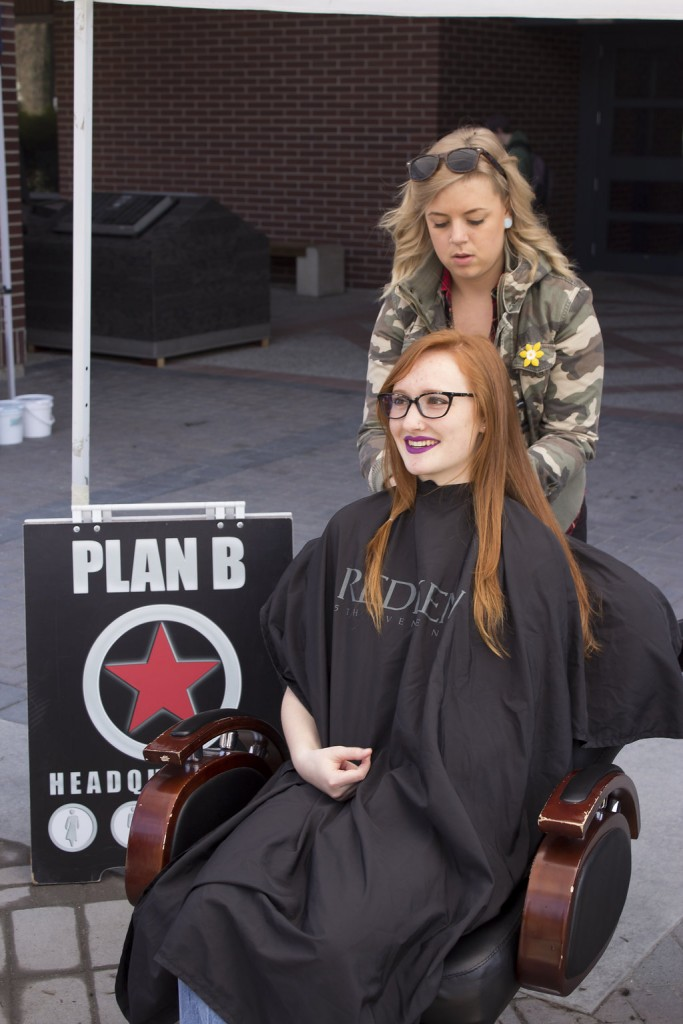 Kelowna Hair Salon - Plan B supports cuts for a cure - Courtney prepping long hair for cut