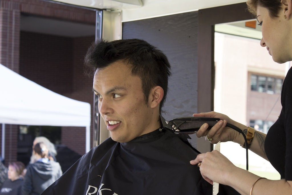 Kelowna Hair Salon - Plan B supports cuts for a cure - guy getting head shaved
