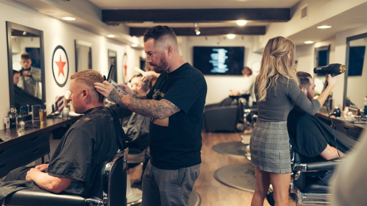 Plan B Barbers giving haircuts at our Kelowna barbershop