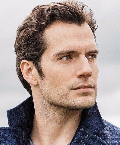curly windswept hairstyle on mature man